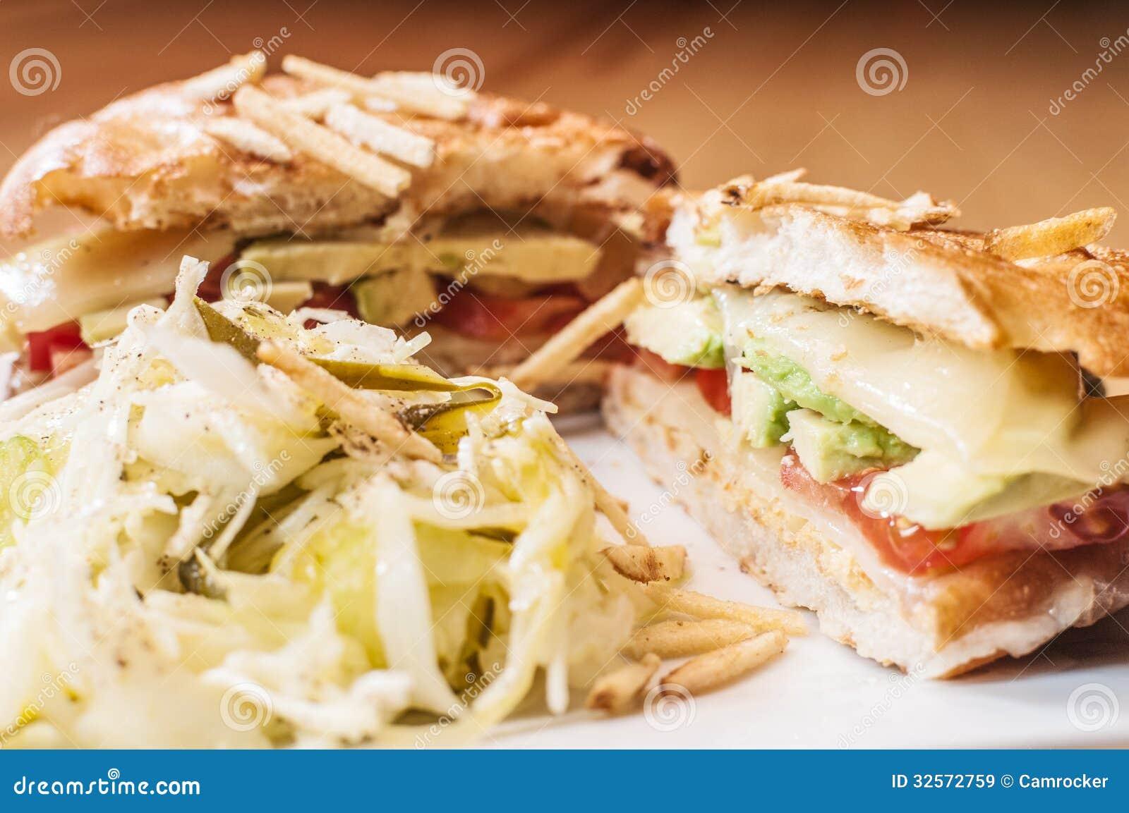 vegetarian panini with avocado, tomato, and gruyere cheese.