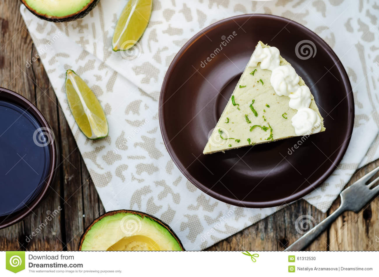 Avocado lime cheesecake on a dark wood background. toning. selective ...