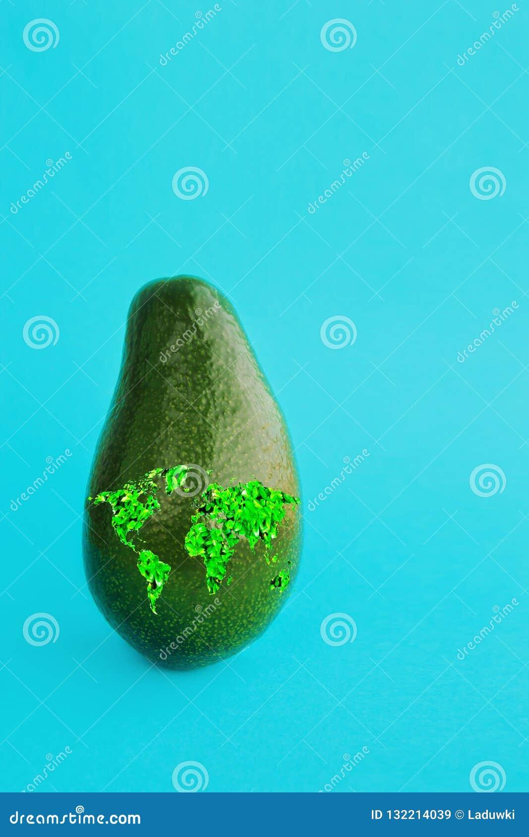 Avocado maturo verde con una mappa di mondo per illustrare uno stile di vita sano, bio- ristorante di dieta vegetariana adeguata