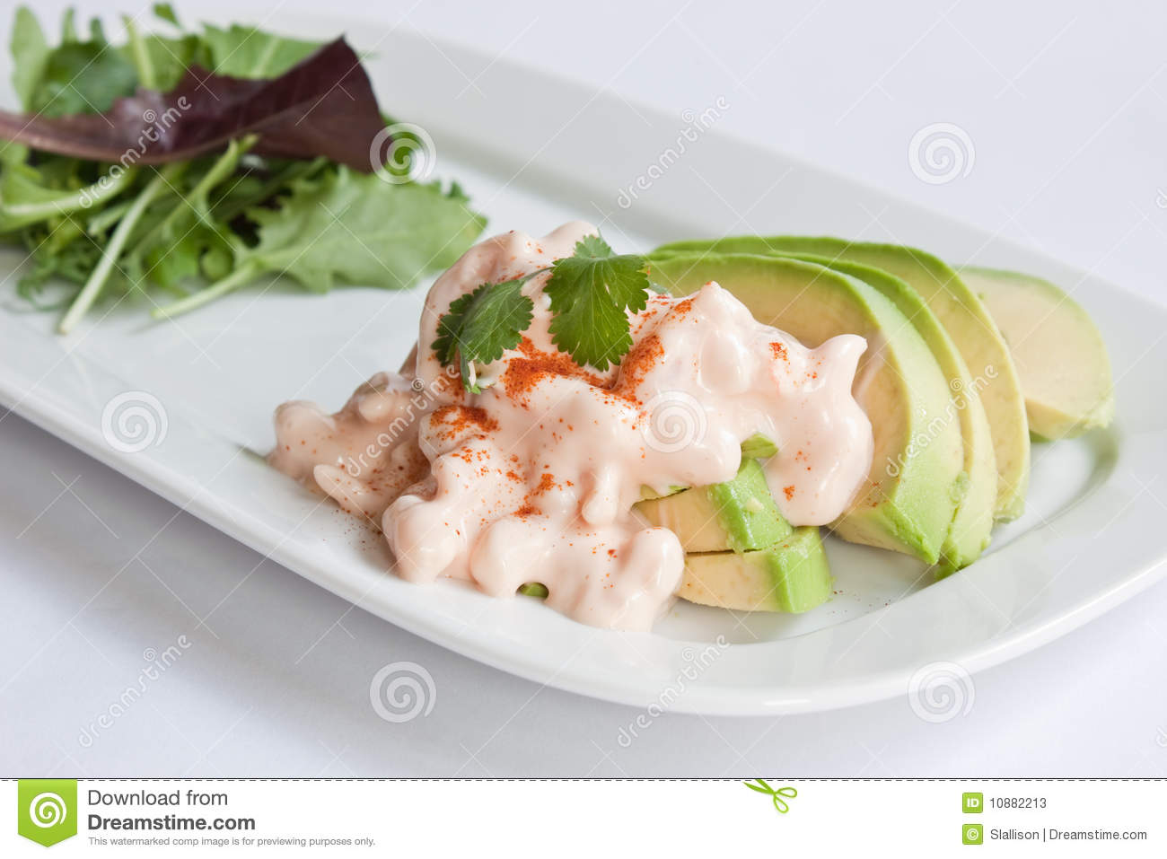 Slices of avocado topped with prawns in a marie rose sauce served with ...