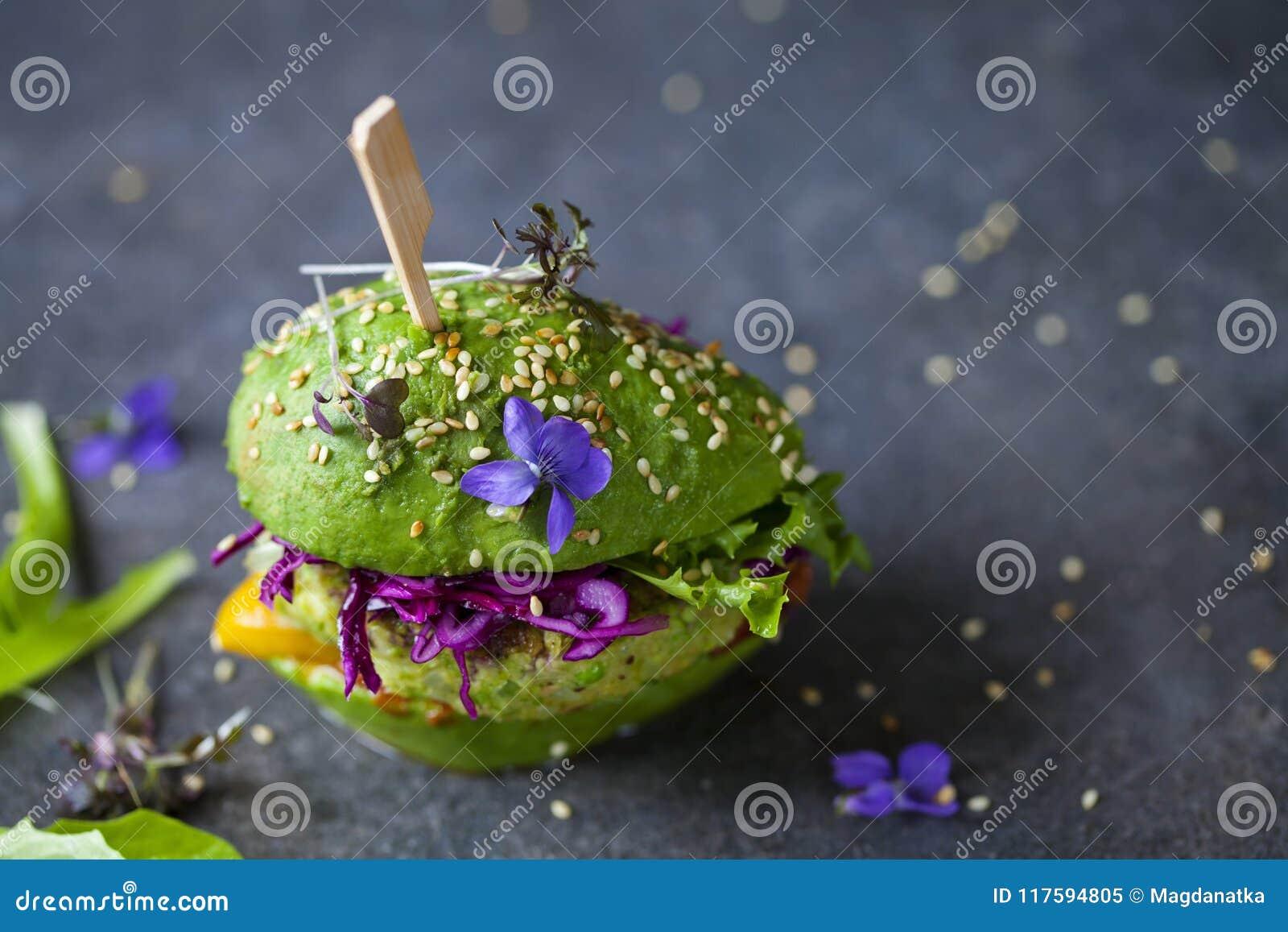 Avocado burger with green patty