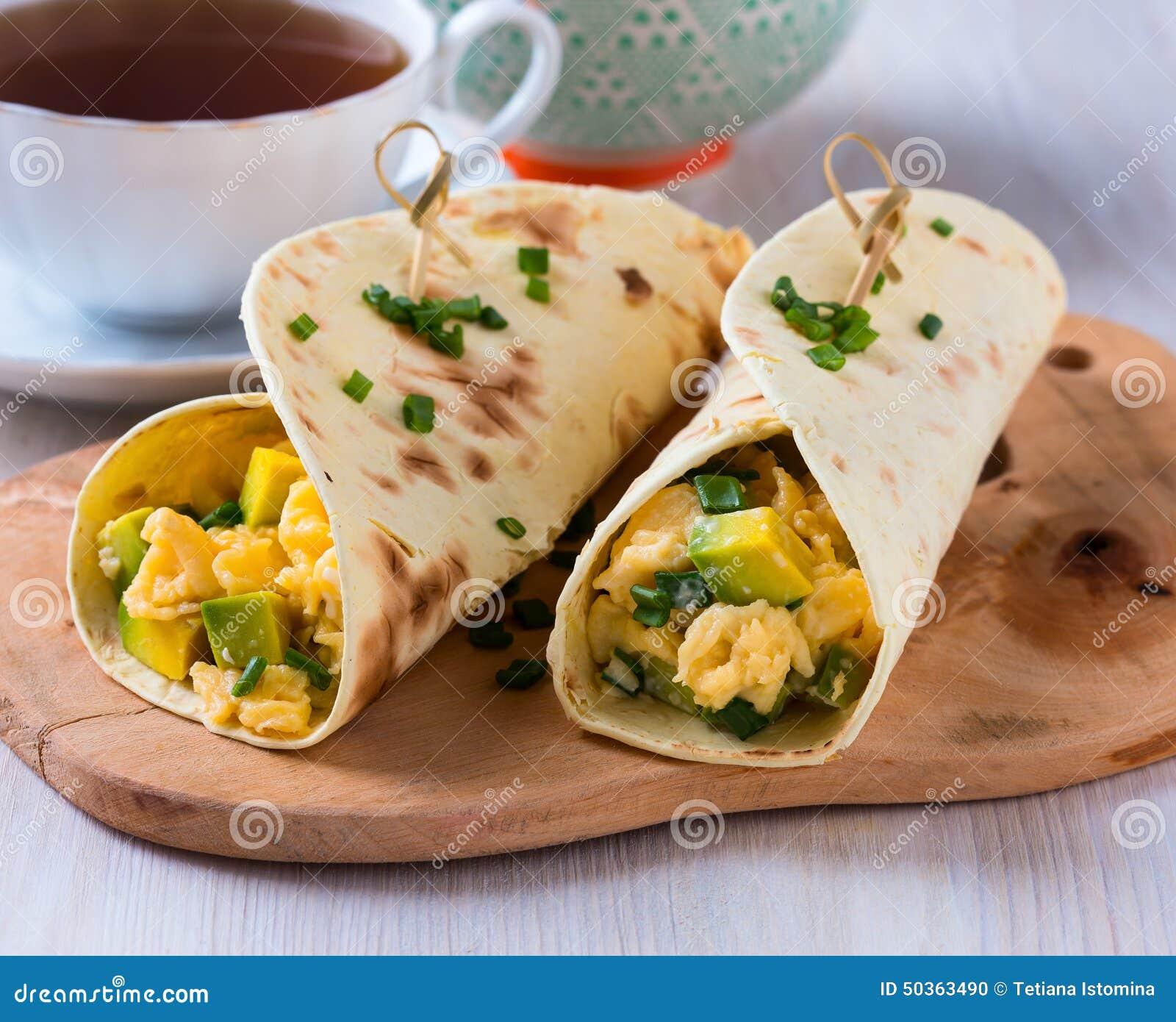 Homemade avocado scrambled egg wraps for healthy breakfast.
