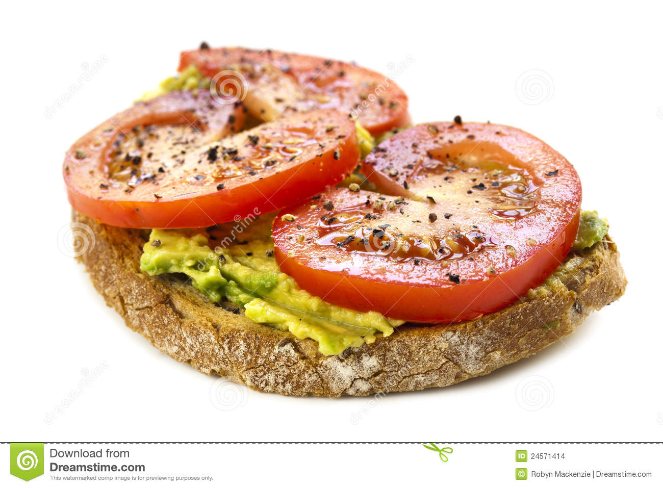 Open sandwich topped with avocado, tomato, and ground pepper. Isolated ...