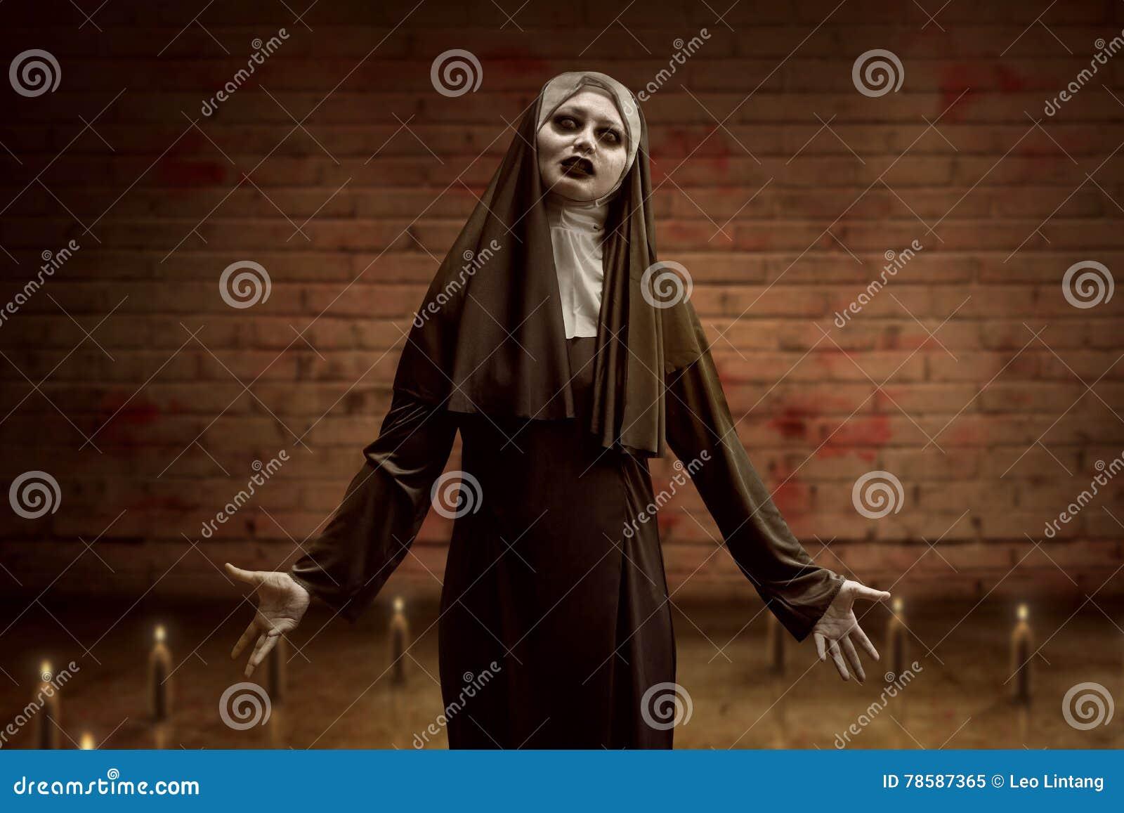 awful asian nun woman begin ritual inside a candle circle stock
