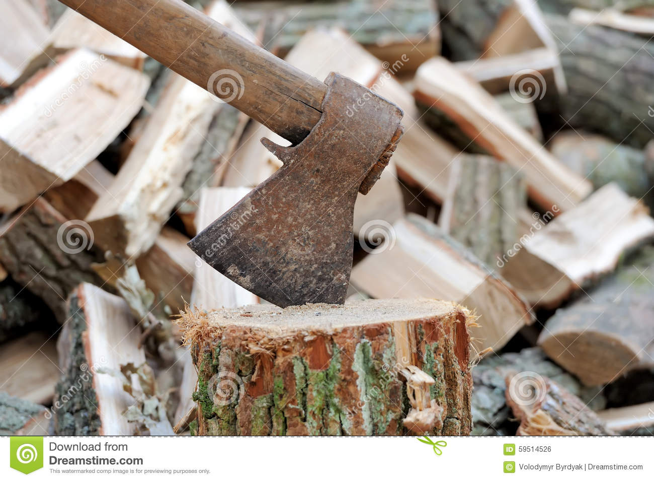 Ax in a log on firewood stock photo image