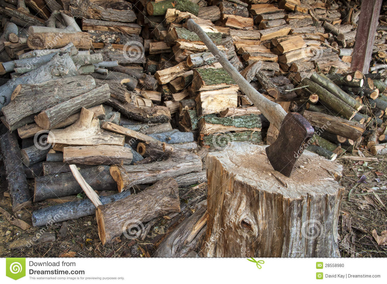 Axe and wood pile stock photo image