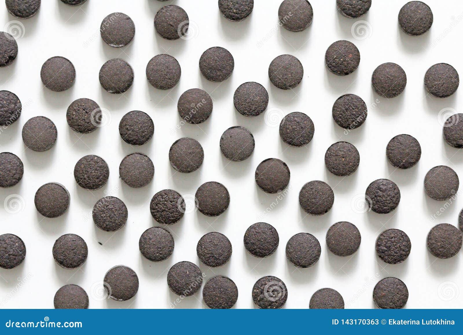 Ayurveda piller Växt- naturliga indiska piller, Ayurveda behandling Ayurvedic medicinört Bakgrund av pillret eller svart brunt