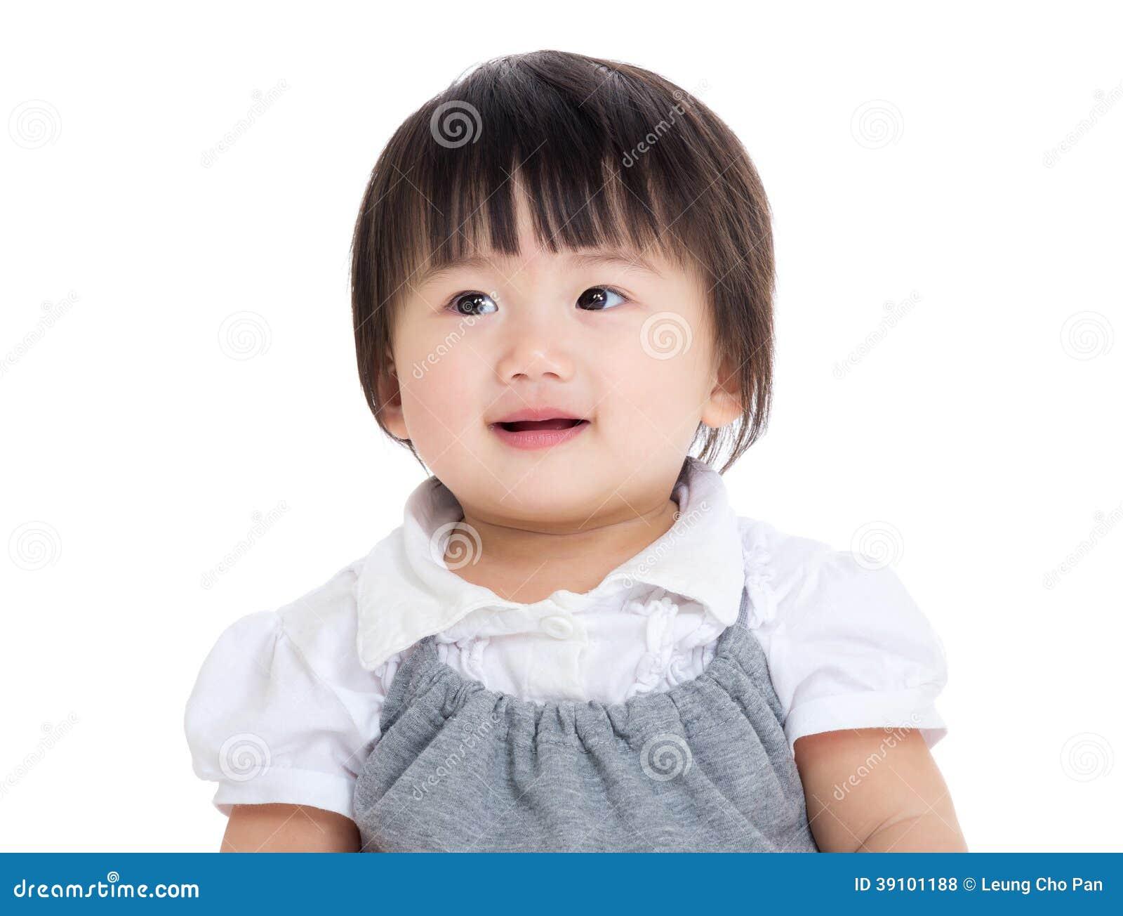 Aziatisch babymeisje die opzij kijken