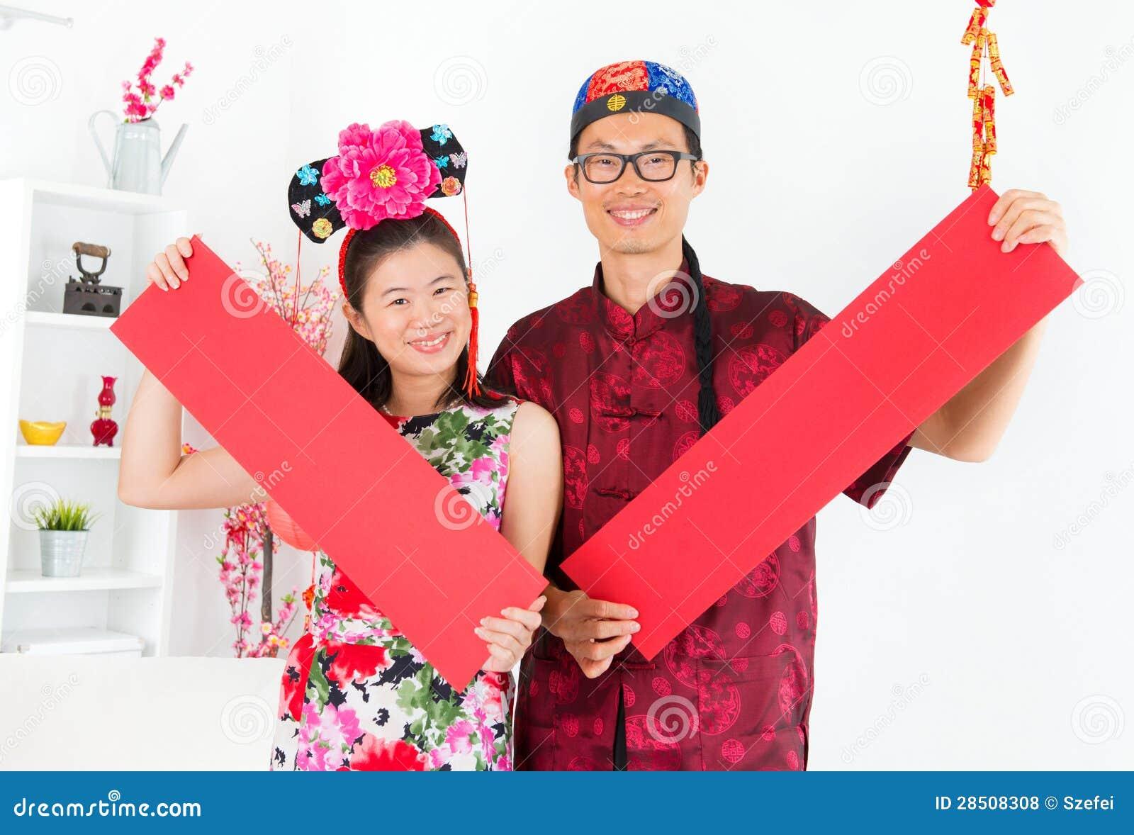 Azjatyccy ludzie Pokazuje czerwonej wiosny przyśpiewki