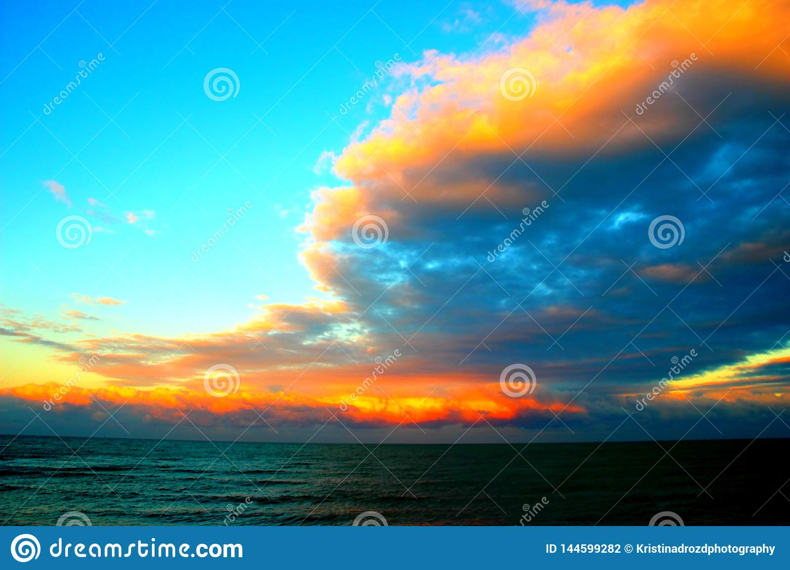 Amazing clouds over the sea during sunset