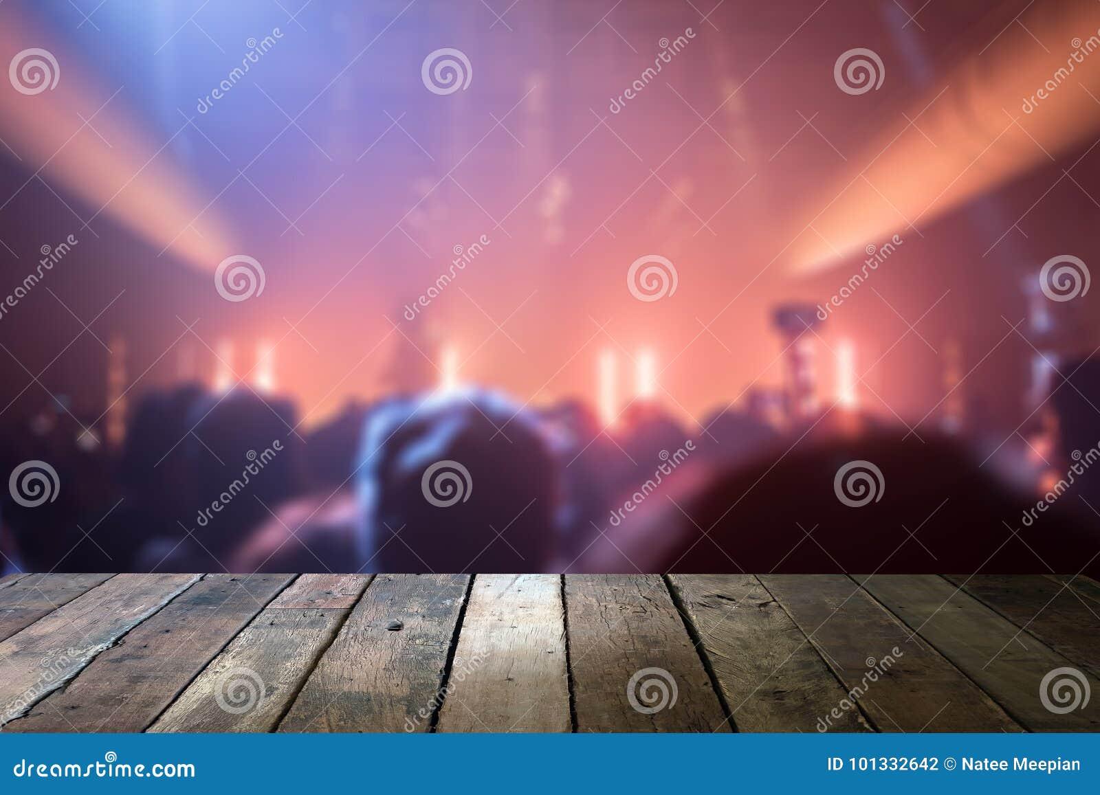 Bästa skrivbord med ljus bokeh i konsertsuddighetsbakgrund, trätabl