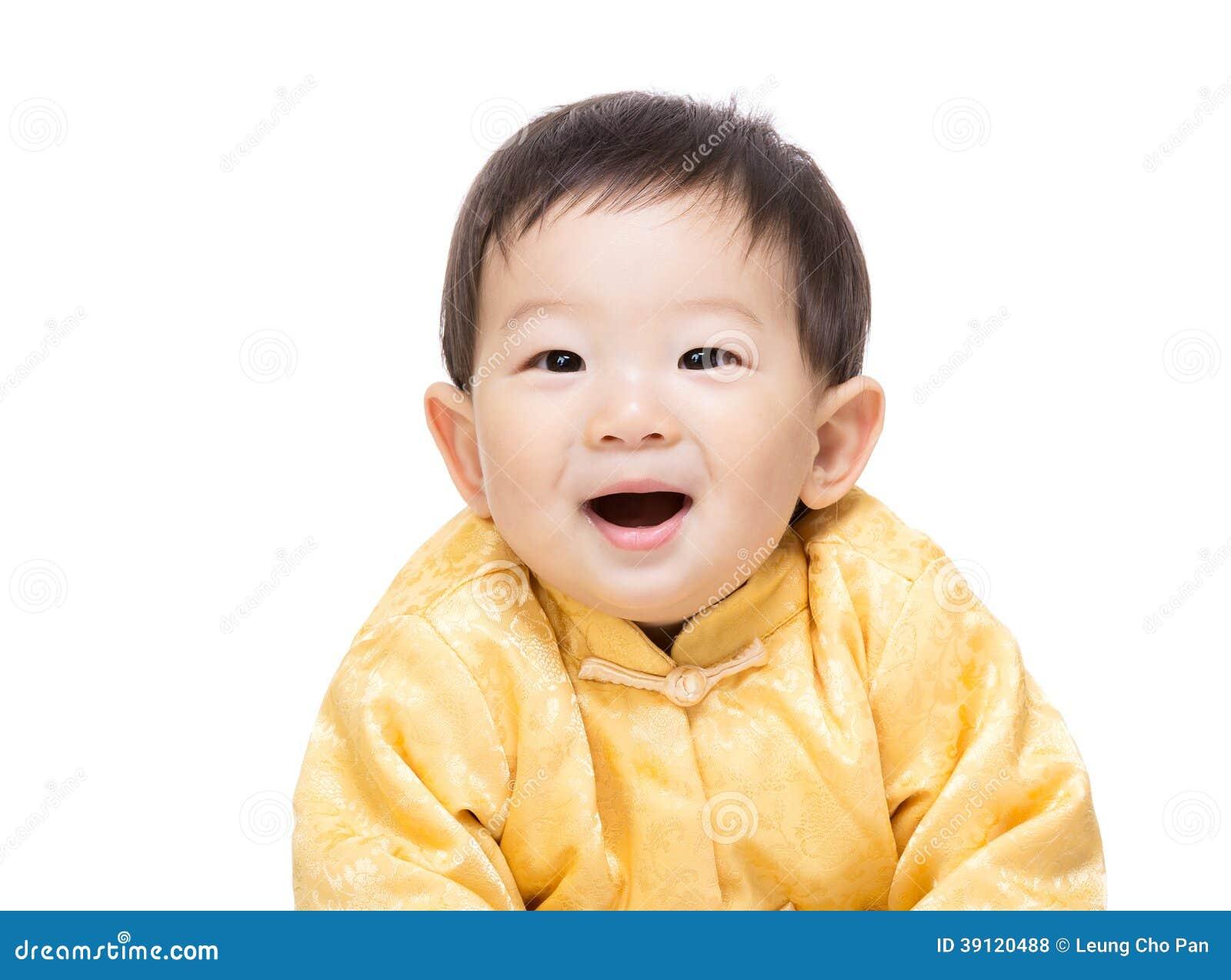 Bébé chinois avec le costume traditionnel