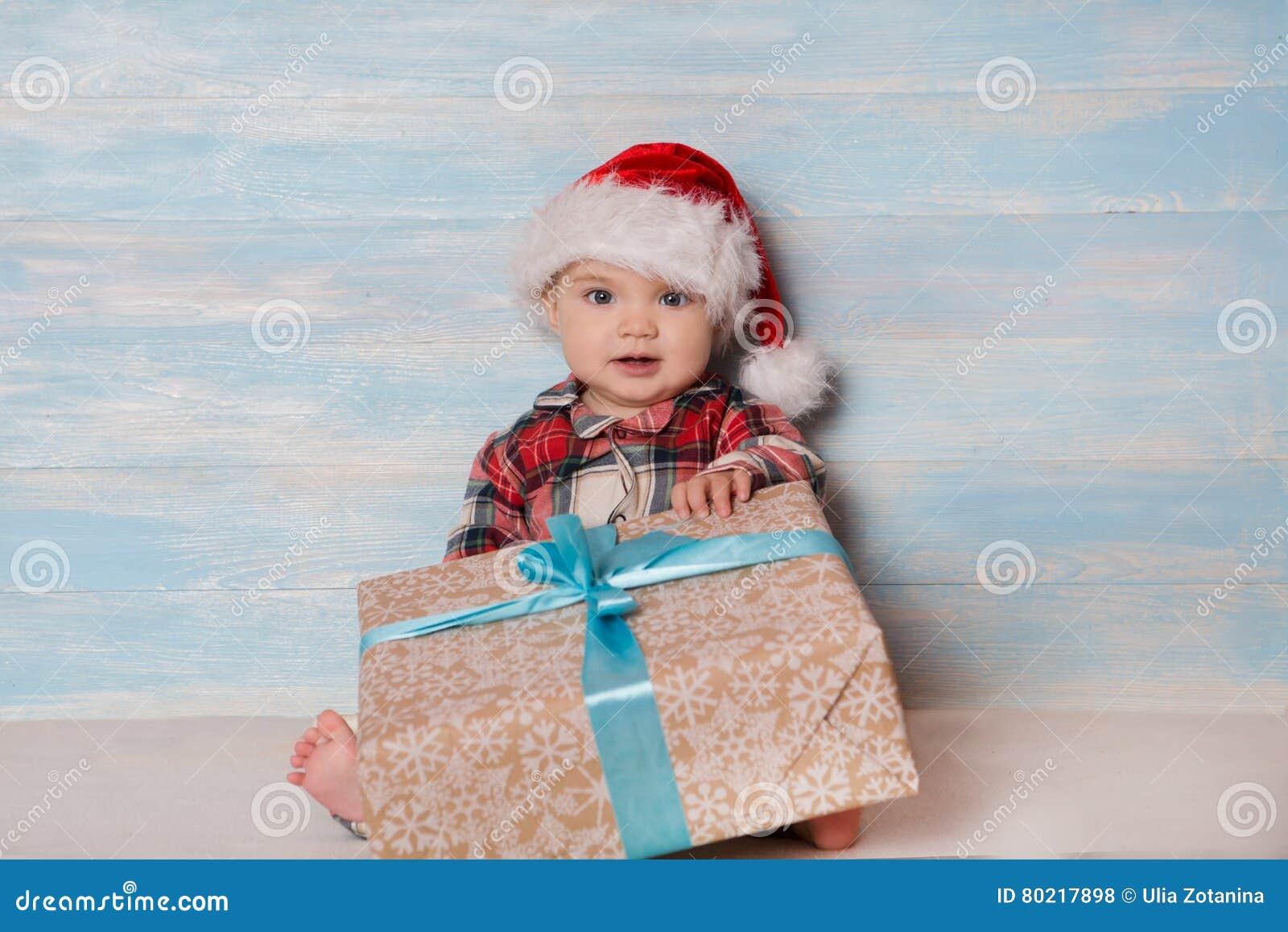 Bébé de Noël dans le chapeau de Santa