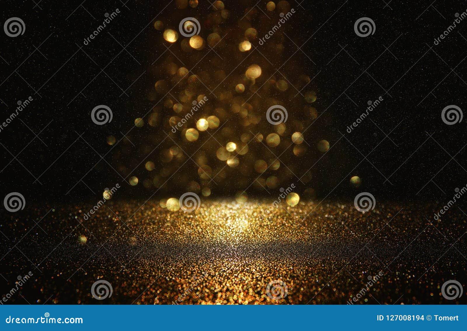 Błyskotliwość rocznik zaświeca tło czarne złoto skupiający się