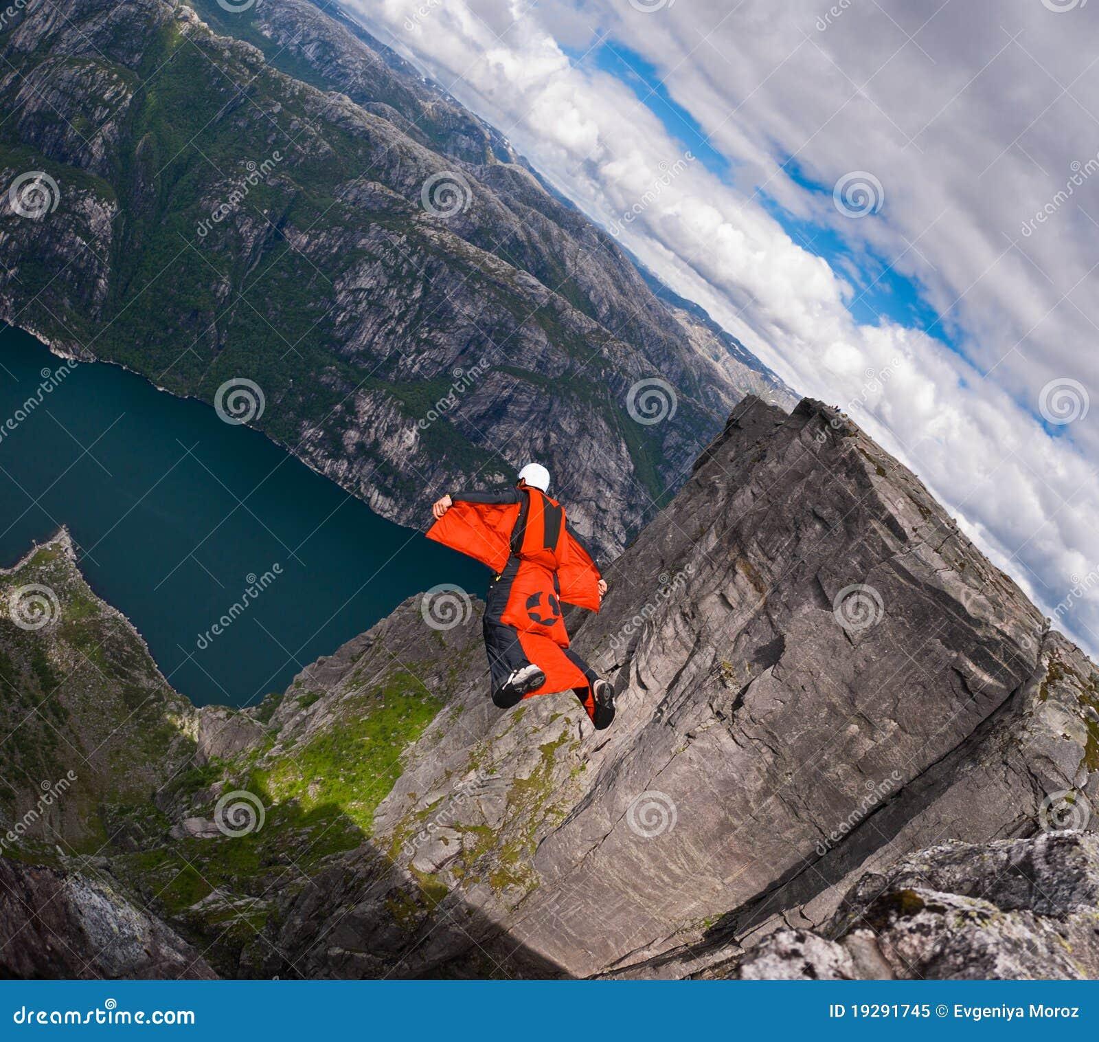 B.A.S.E. jumper in wingsuit jumps at Kjerag