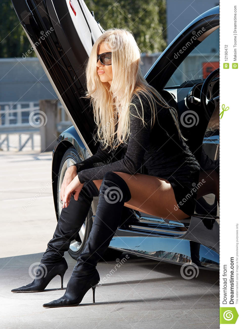 Babe Sitting In A Car Stock Photography