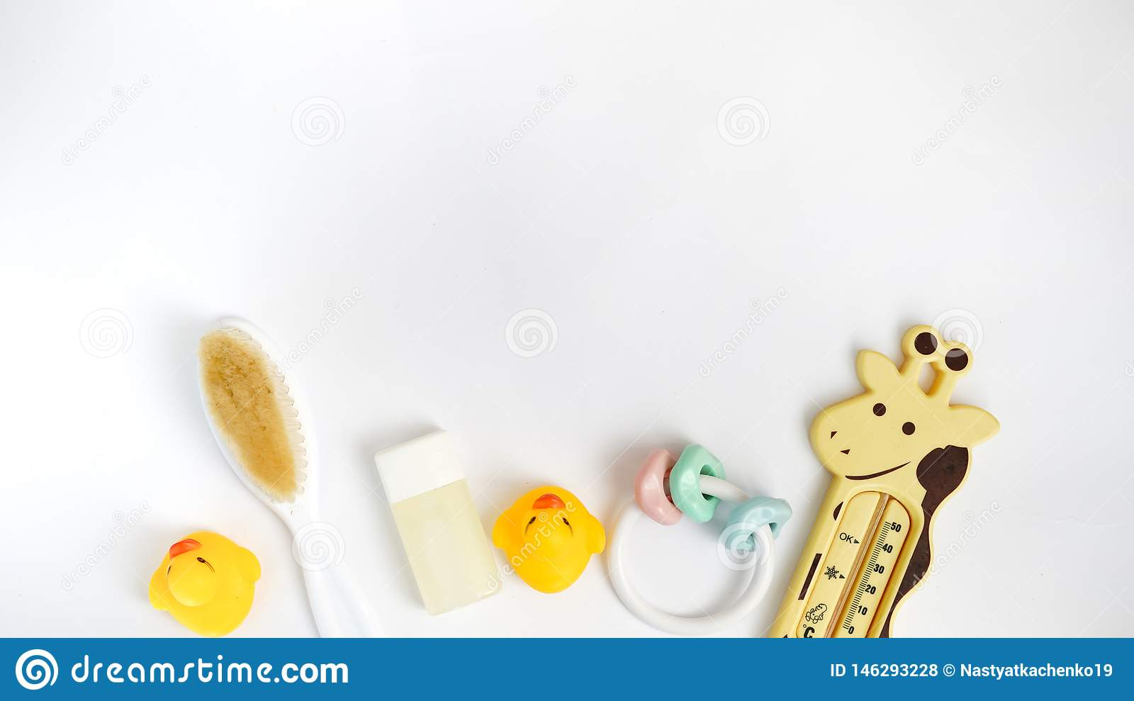 Baby bath products isolated on white background with copy space. flat lay soap bar, yellow rubber duck and liquid soap, toy