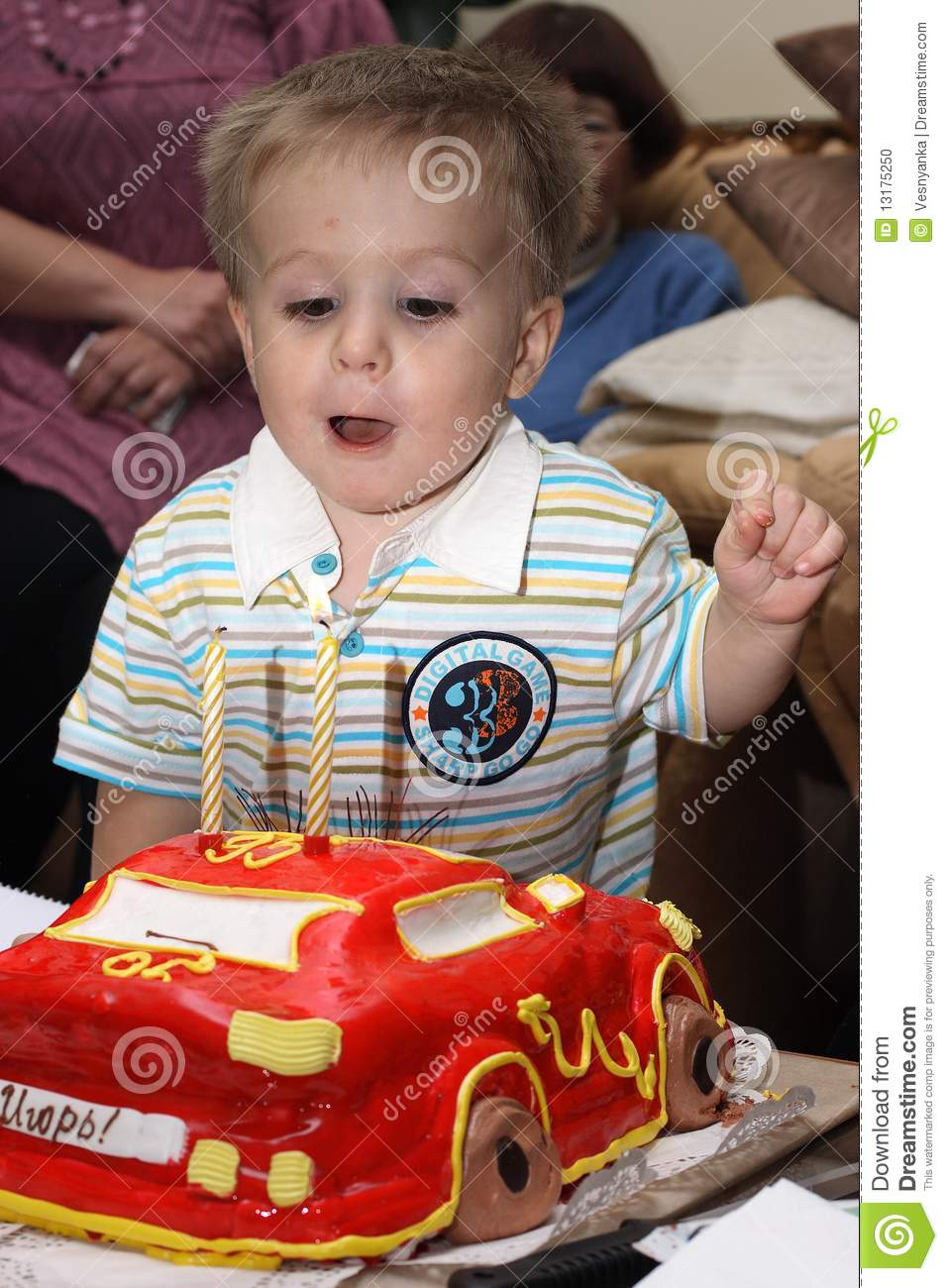 2 Years Old Little Boy Celebrating Birthday Ready To Snuff Out The Candle On Cake