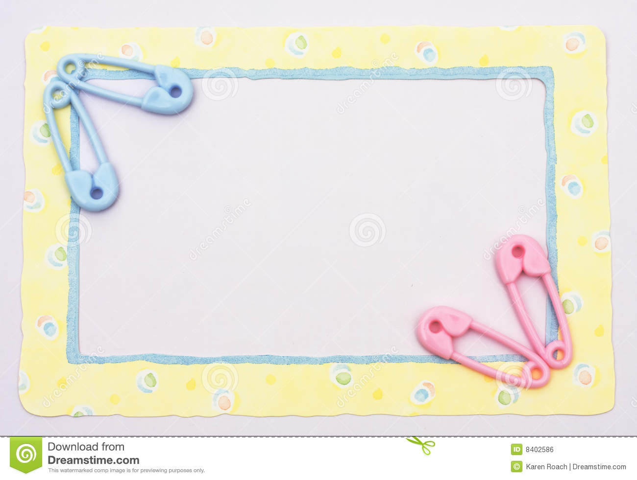Blue diaper pins sitting on a yellow alphabet background baby border