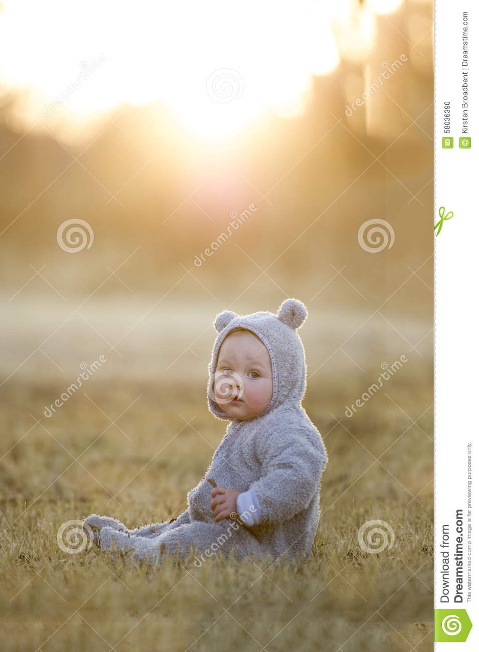 Baby Boy In A Bear Suit At Sunset Stock Photo Image