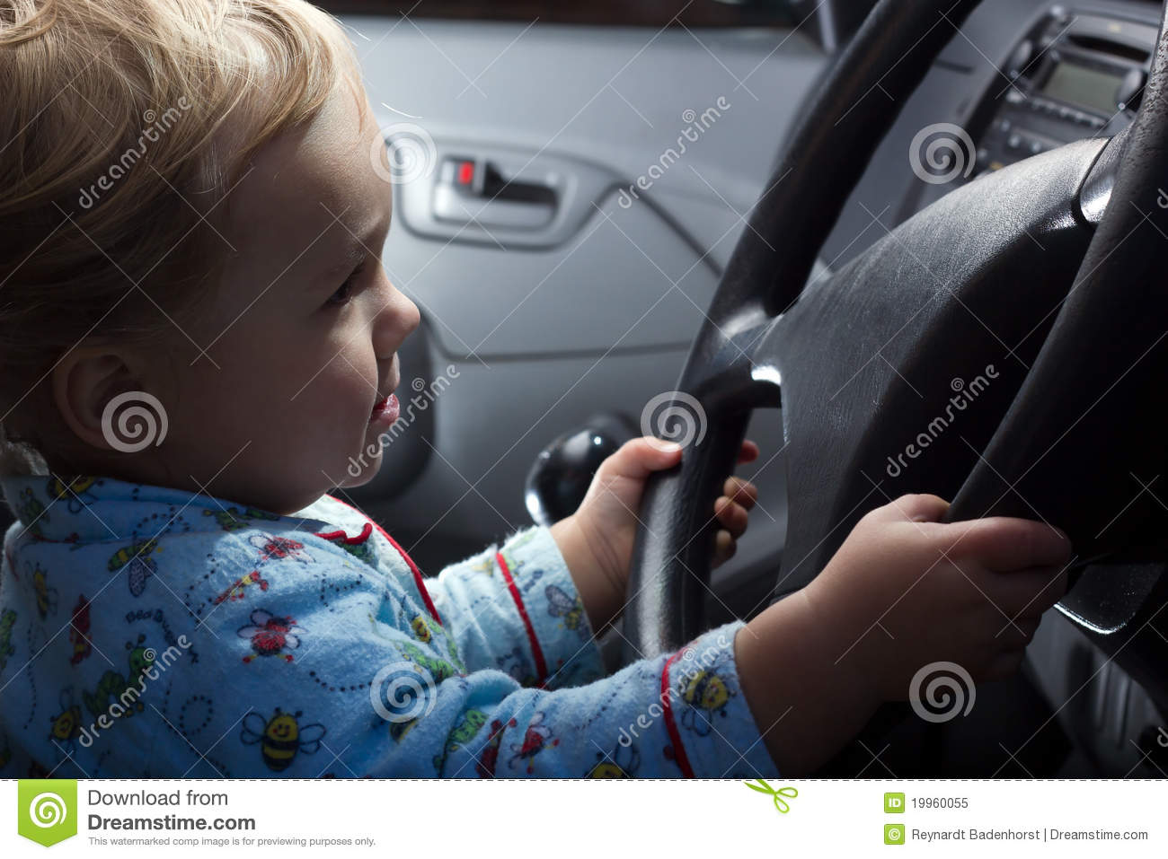 Behind The Steering Wheel : Baby boy behind the steering wheel royalty free stock