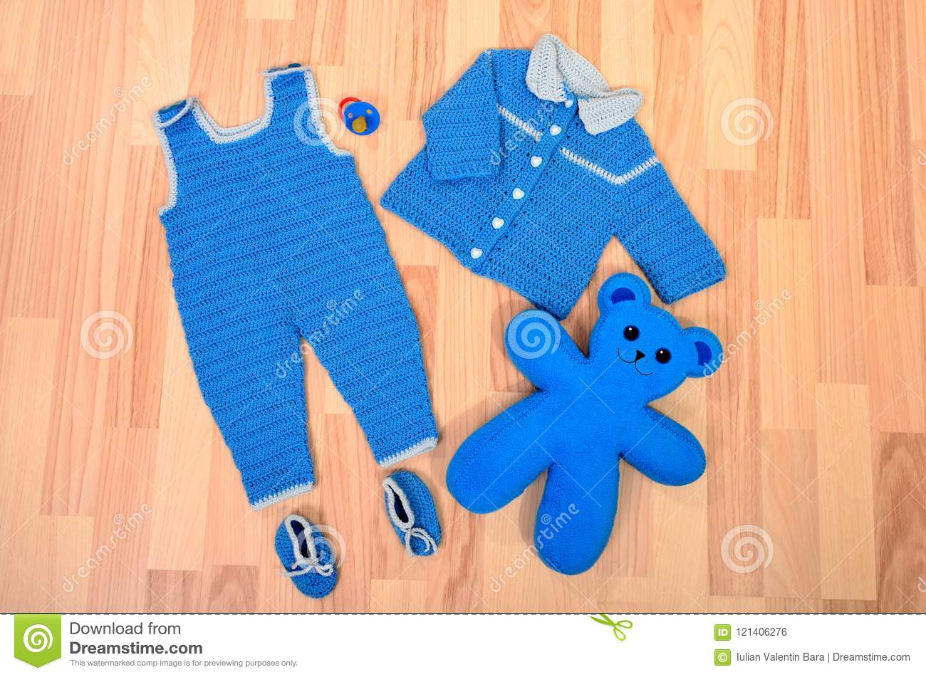 c7653f8f9 Baby Boy Blue Winter Clothes And Shoes Lying On The Floor. Stock ...