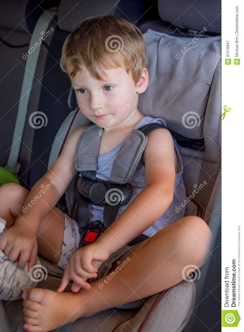 Portrait Of Cute Toddler Boy Sitting In Car Seat Child Transportation Safety