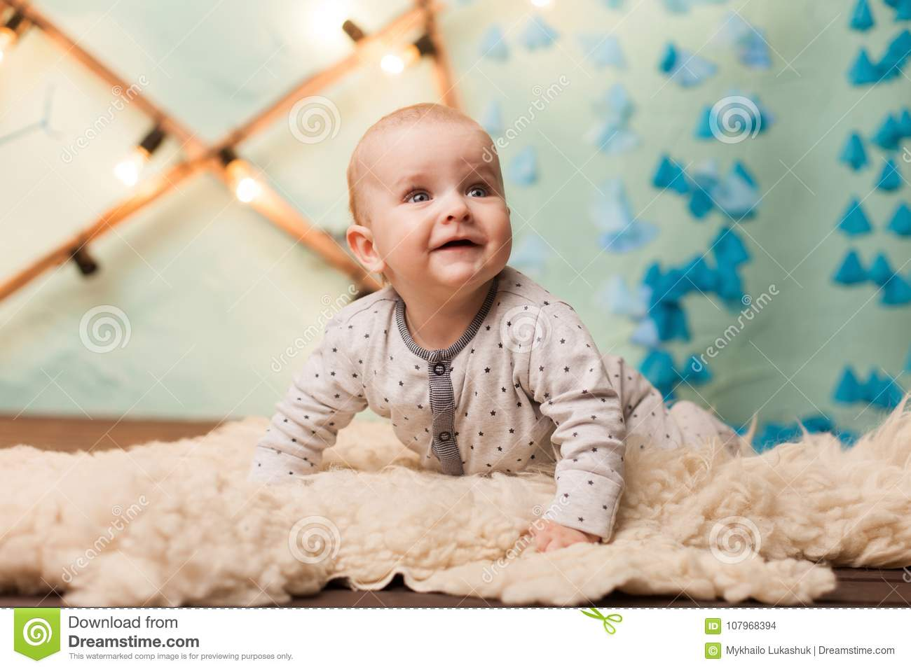 Baby Boy On Carpet With Decorations In Studio Stock Photo Image Of People Child 107968394