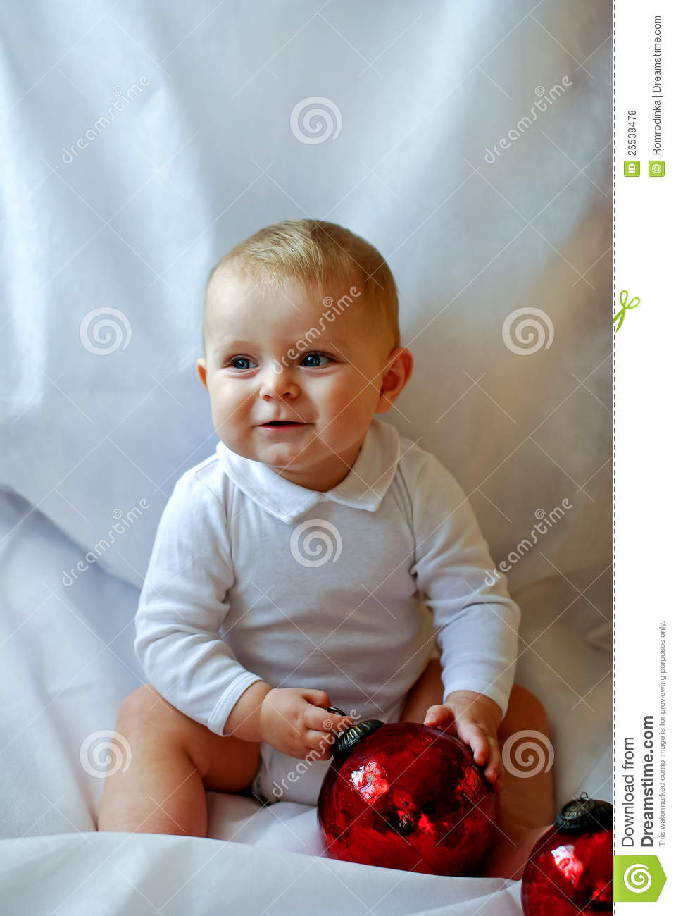 0418b5972b0 Baby Boy With Christmas Balls On White Background Stock Photo ...