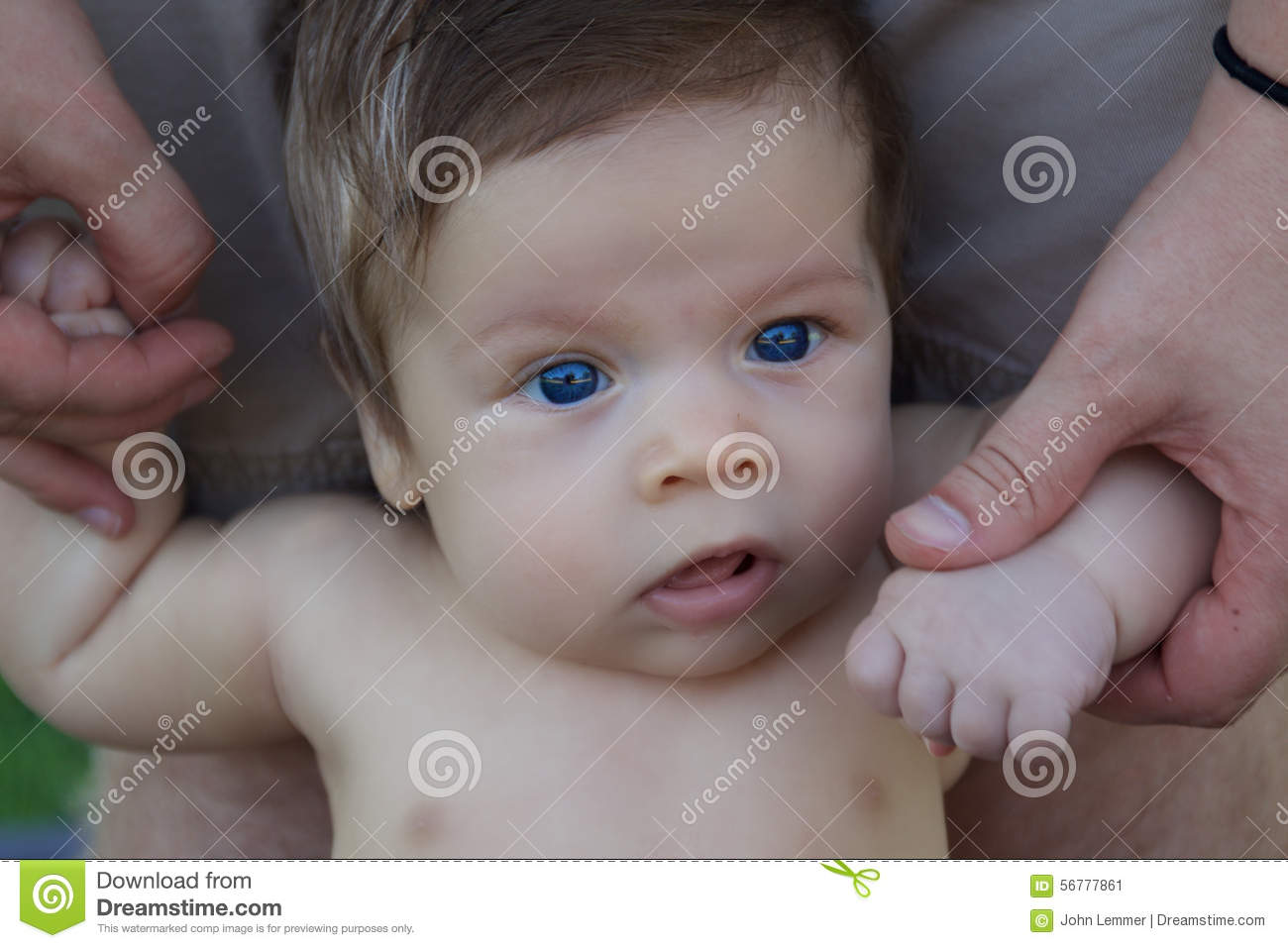 smiling baby boy with blue eyes close up stock photo