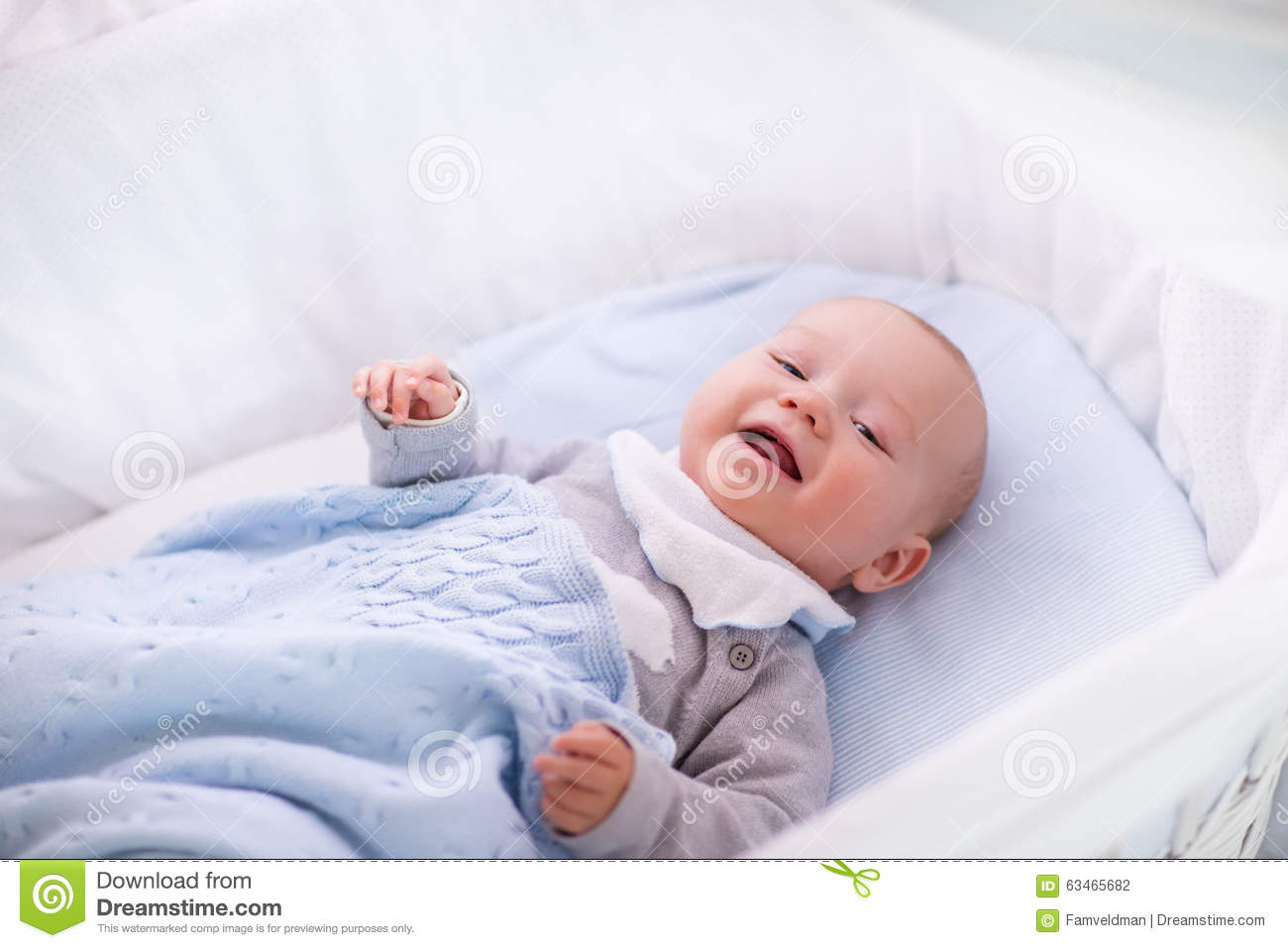 baby boy in a crib under knitted blanket stock photo. Black Bedroom Furniture Sets. Home Design Ideas