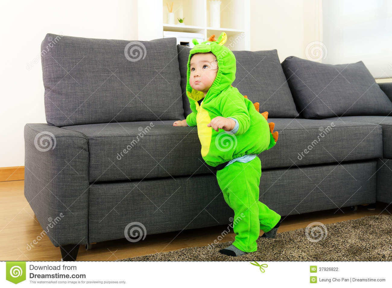 baby boy with dinosaur halloween party costume stock photo - image
