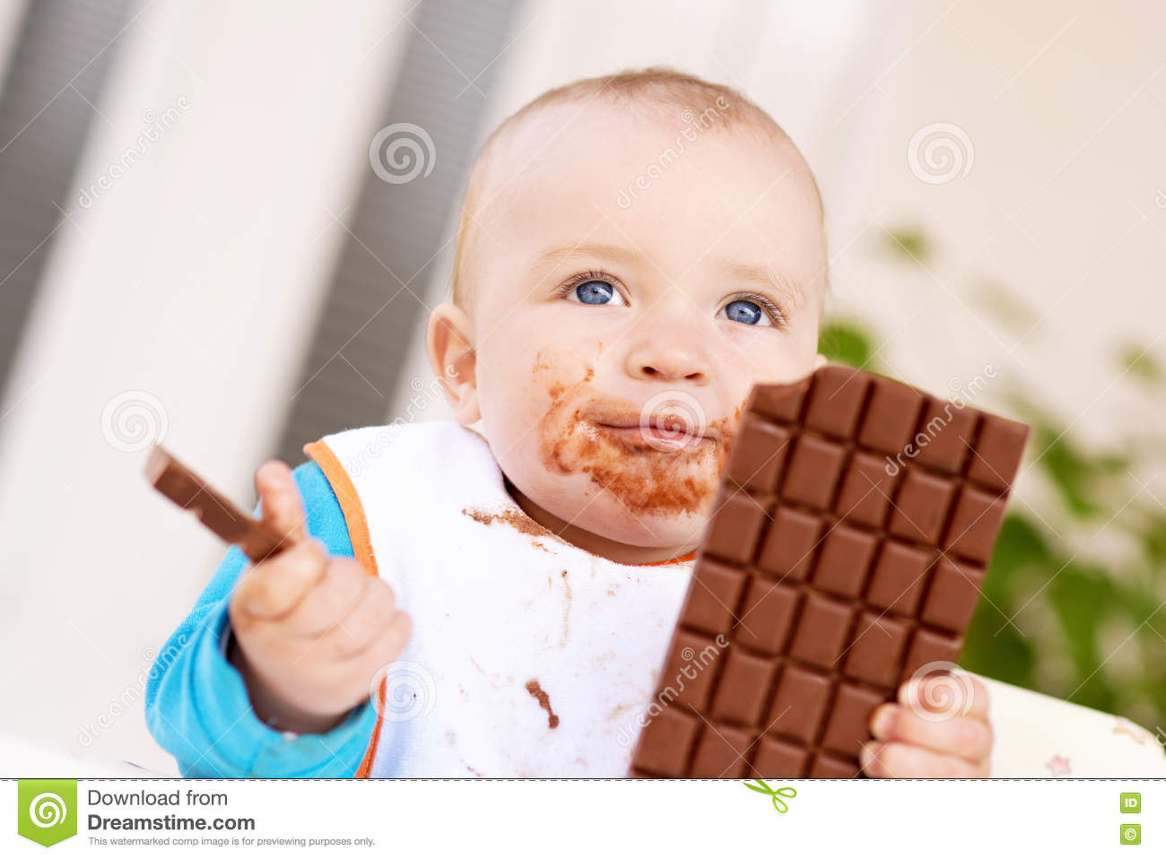 Baby Boy Eating Chocolate Stock Photo - Image: 76892648