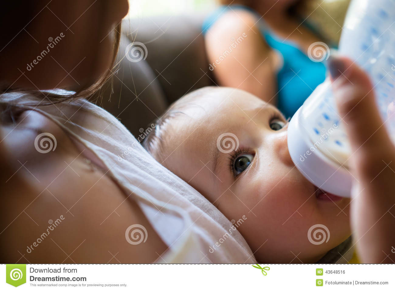 Baby boy fed by mother