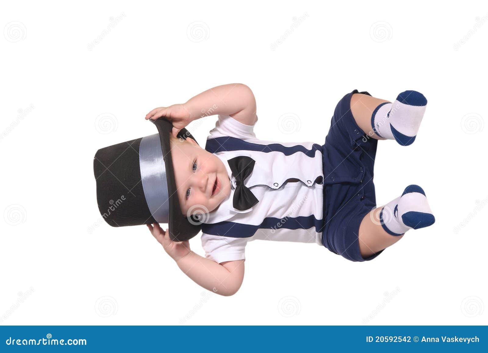 Baby boy gentleman putting on cylinder hat