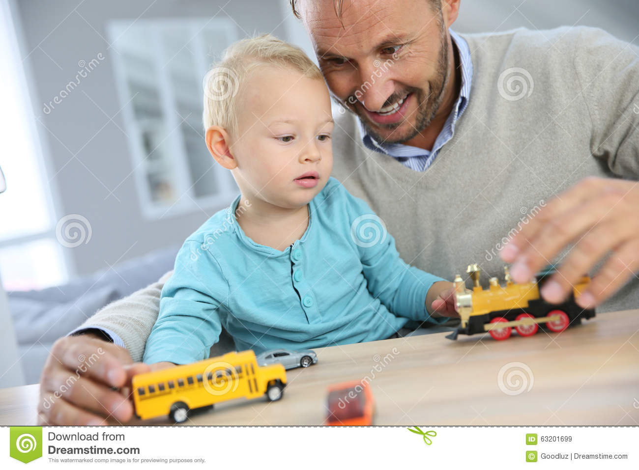 Boy Toys For Dads : Baby boy and his father playing with cars stock image