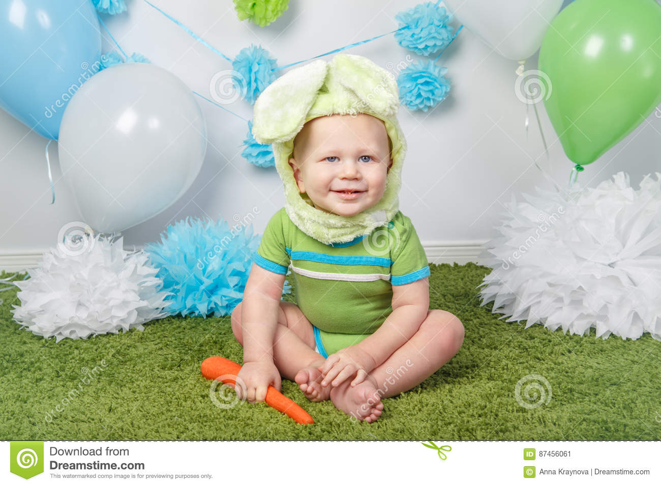 98da59b1ee2 Portrait of cute adorable Caucasian baby boy in holiday Easter bunny rabbit  costume with large ears