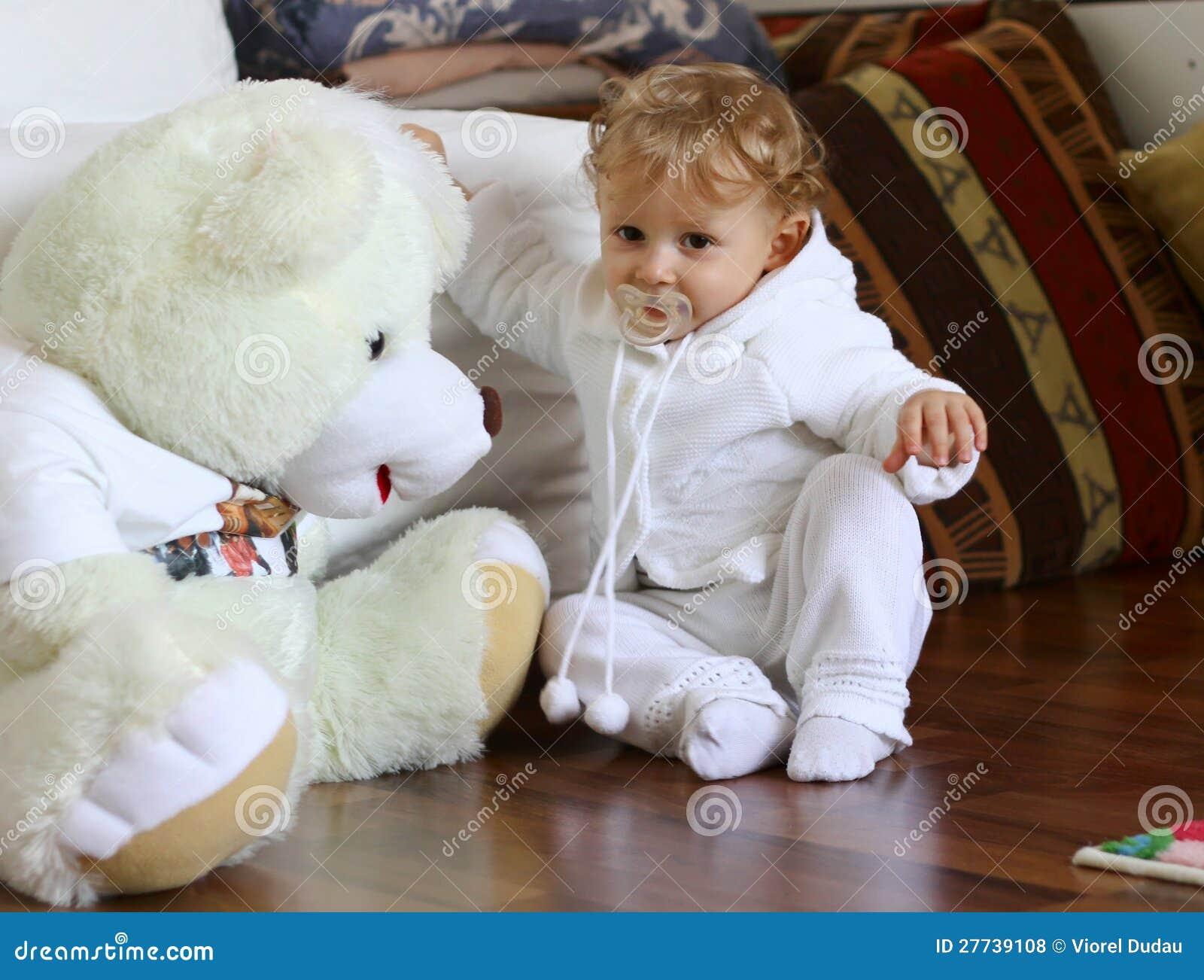 Baby boy with huge teddy bear