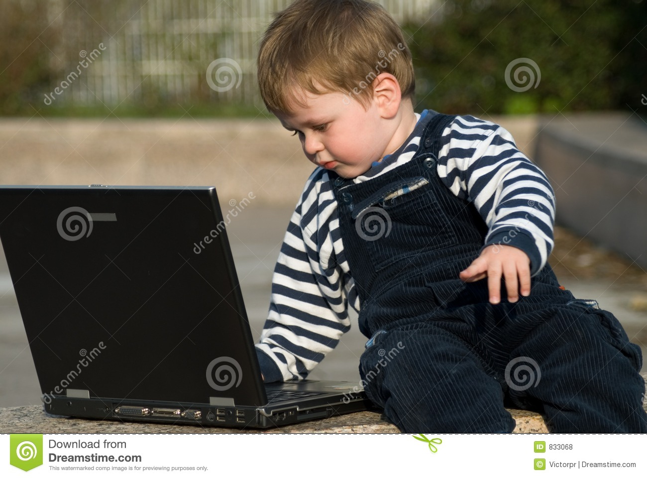 Baby boy with laptop