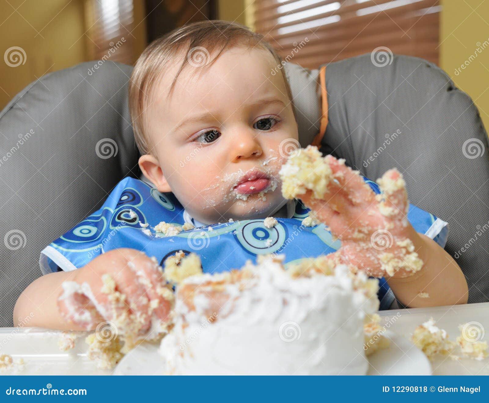 Baby Boy Makes Mess Of Cake Stock Photo