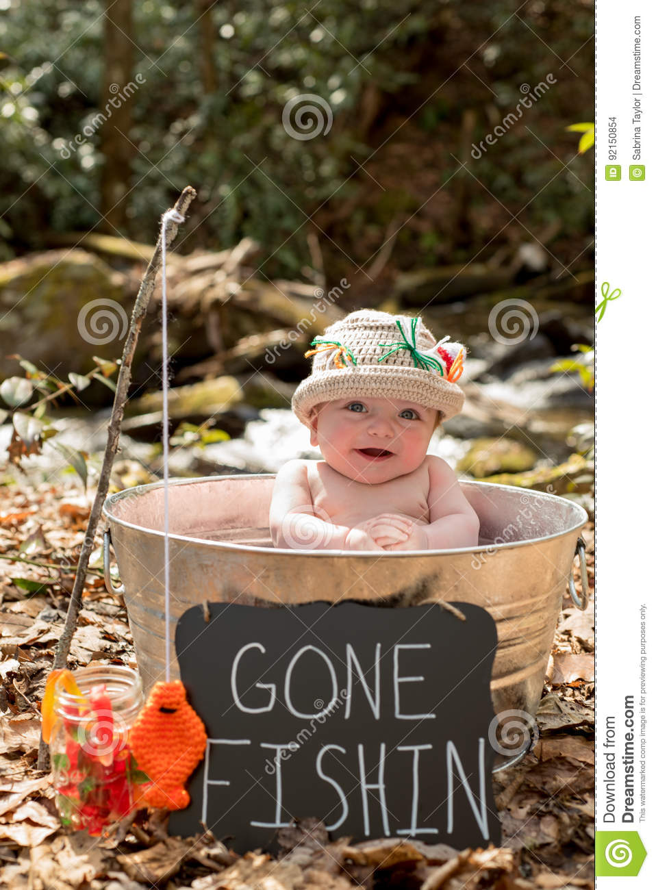 b69564cc4be91 Baby Boy In Metal Pot With Sign Gone Fishing Stock Photo - Image of ...