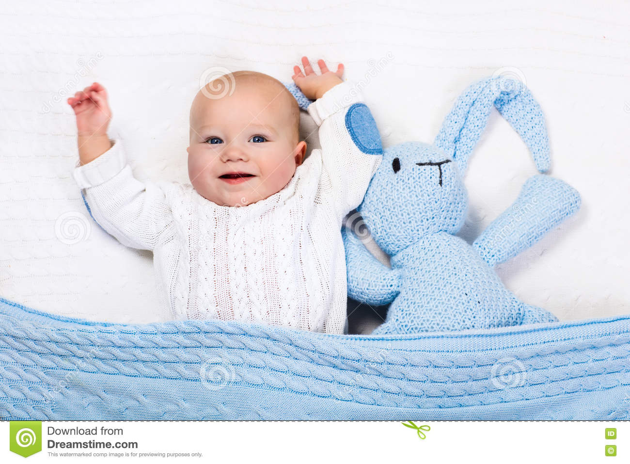 e9d90e3e0703 Baby Boy Playing With Blue Knitted Bunny Toy Stock Image - Image of ...