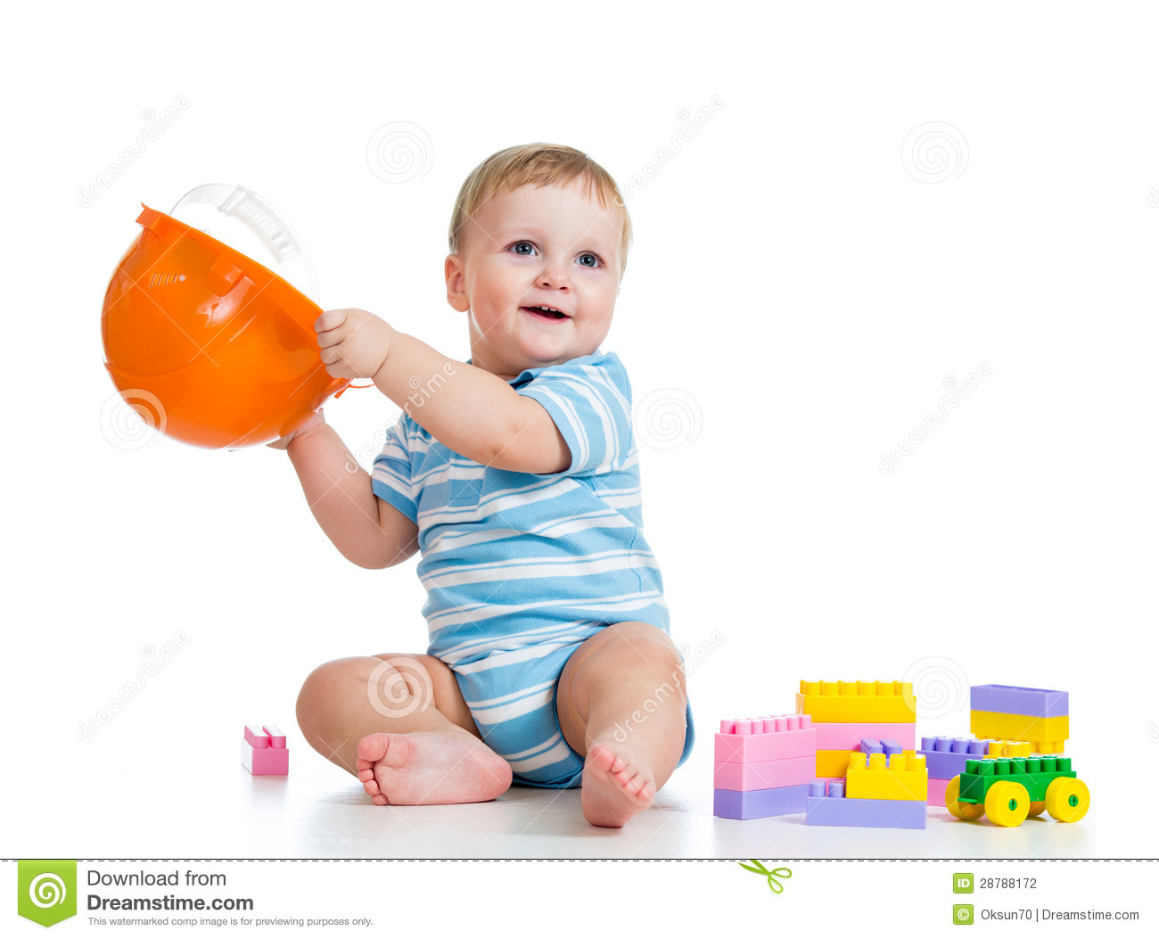 Baby boy playing with building blocks toy