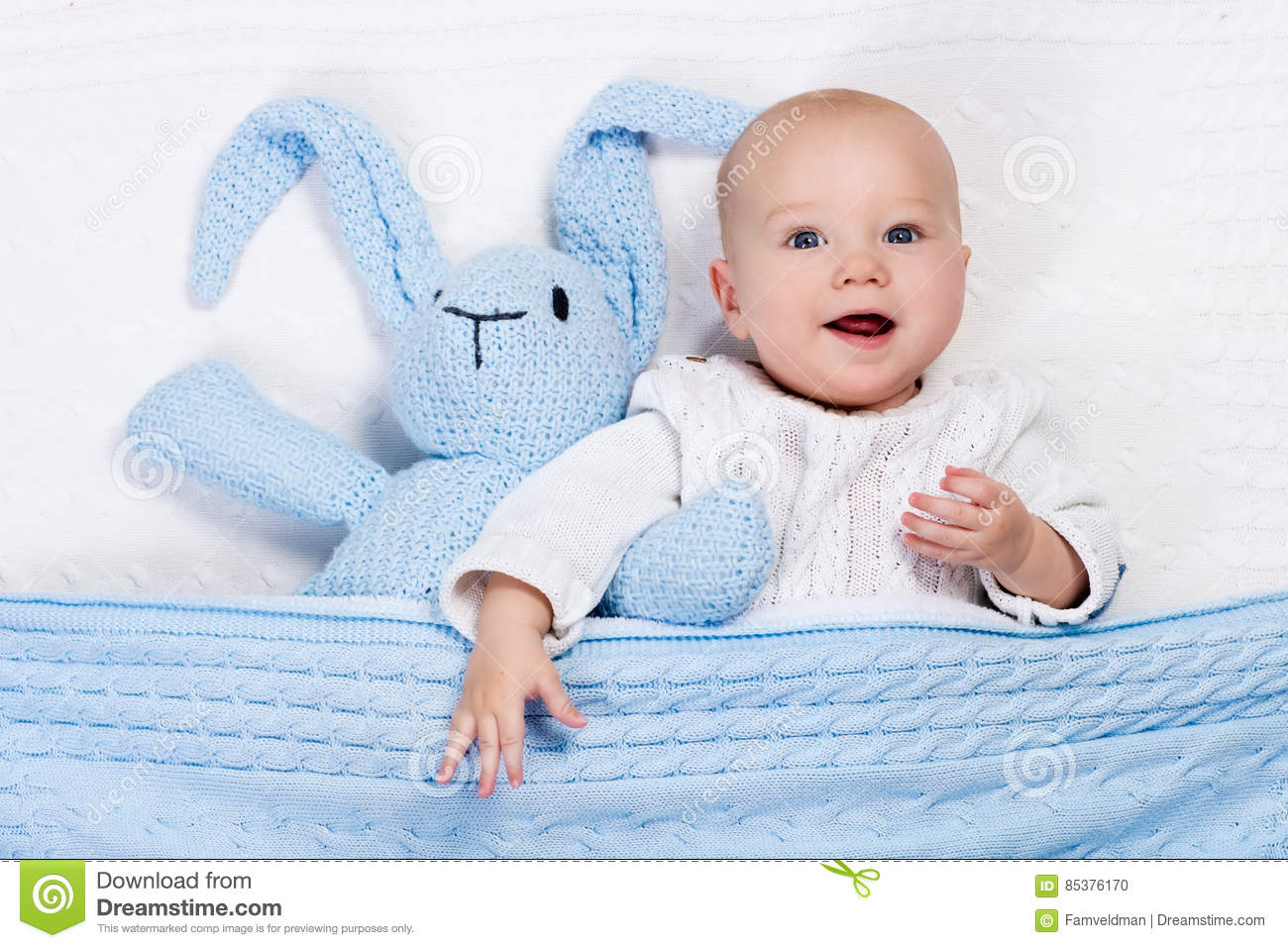 885f352de81d Baby Boy Playing With Bunny Toy In Bed Stock Photo - Image of ...