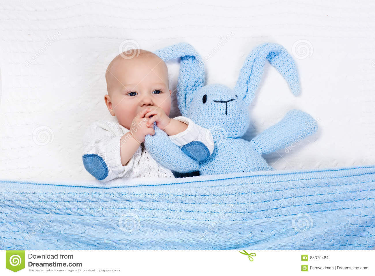 a40a088e22cb Baby Boy Playing With Bunny Toy In Bed Stock Photo - Image of bunny ...