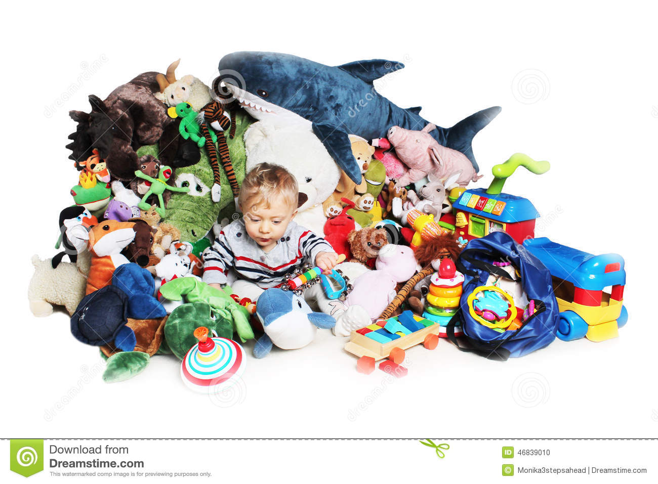 Boy Toys Background : Baby boy playing with his toys stock photo image