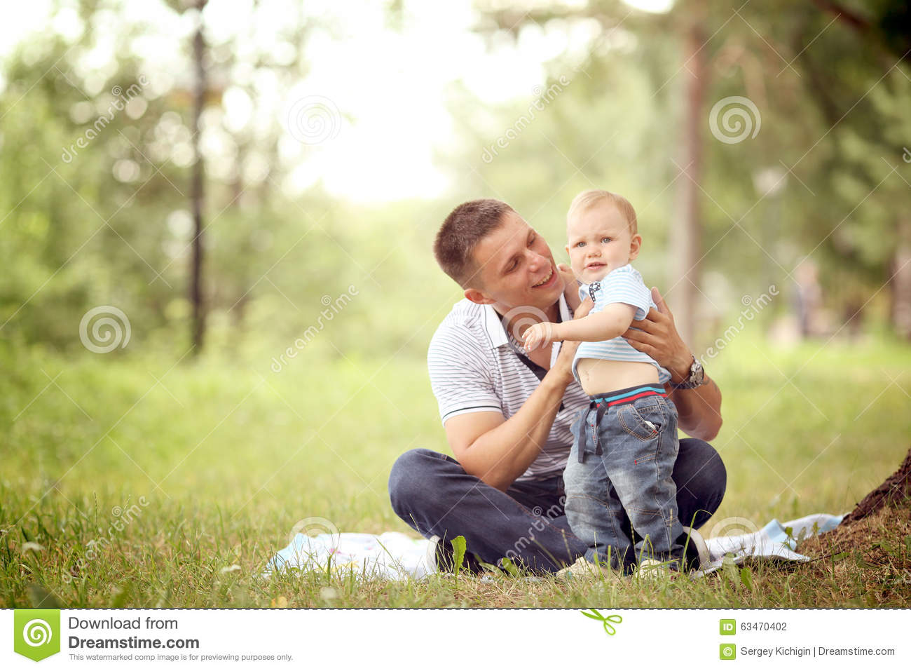 Baby boy playing in the park with dad