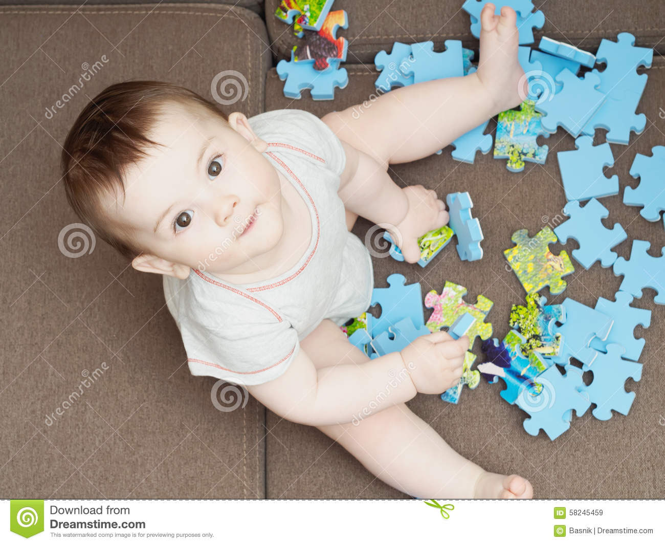 Baby Boy Playing With Puzzle Pieces On Sofa In The Living Room At Home Stock Image Image Of