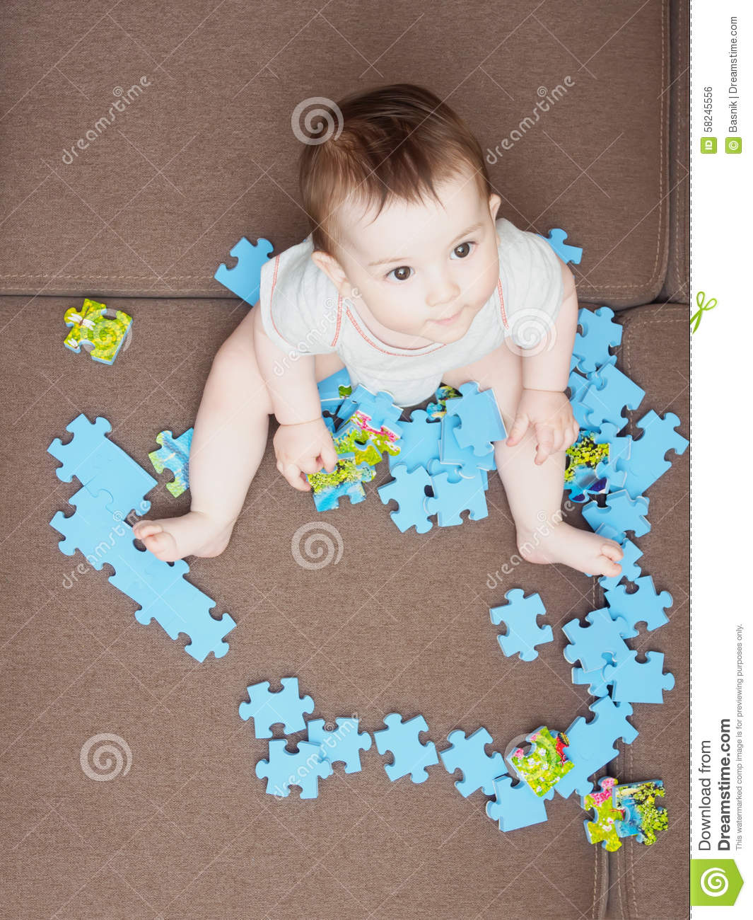 Baby Boy Playing With Puzzle Pieces On Sofa In The Living Room At Home Stock Photo Image 58245556
