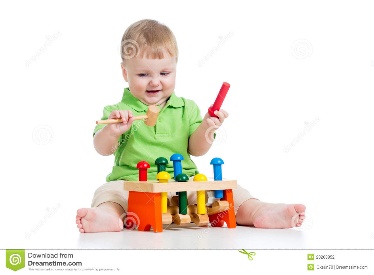 Boy Toys Background : Baby boy playing with toy on white background stock